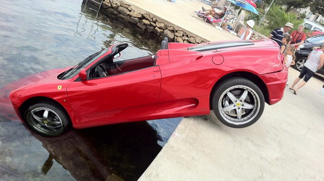 ferrari sinking into a lake