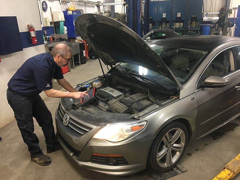 mechanic working on car at crestview autoservice saskatoon